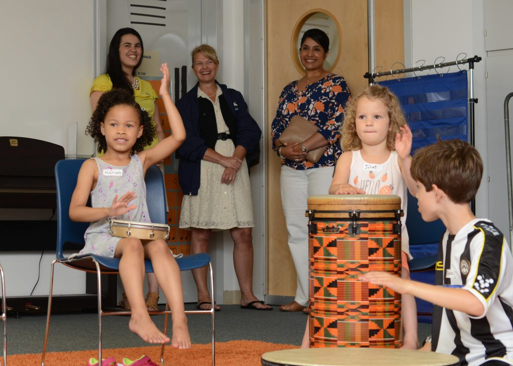 Children having fun playing instruments